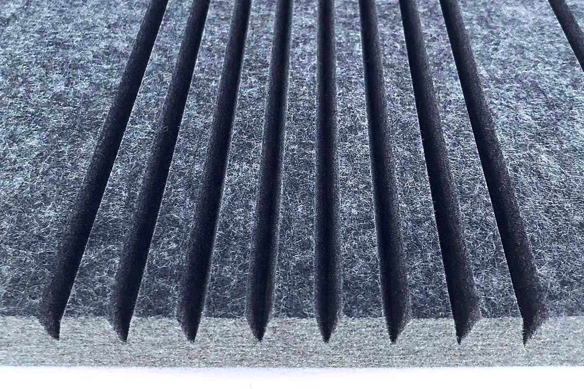 V-cut acoustic panel for radius bend